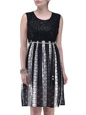 Black Net Dress With  A Sequined Yoke - By