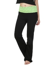 Black Yoga Pants With A  Green Floral Print Foldover Waist - By