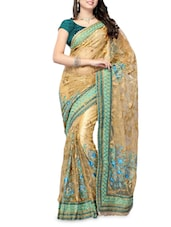 Beige And Green Net Embroidered Sari - By