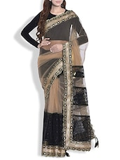 Black And Gold Net Saree With Heavy Border - By
