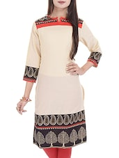 Beige Solid Cotton Kurta With Printed Yoke And Bottom - By