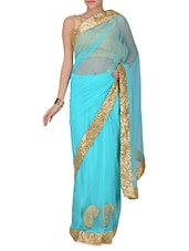 Sky Blue Net Saree With Sequined Border - By