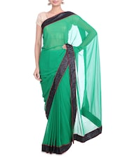 Bottle Green Georgette Saree With Sequin Border - By