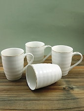 Set Of 4 White Porcelain Coffee And Tea Mugs - By