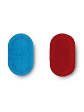 Set Of 2 Red And Sky Blue Oval Reversible Cotton Doormats - By